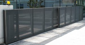 Secure fence and access gate located in Huntsville for commercial and business property